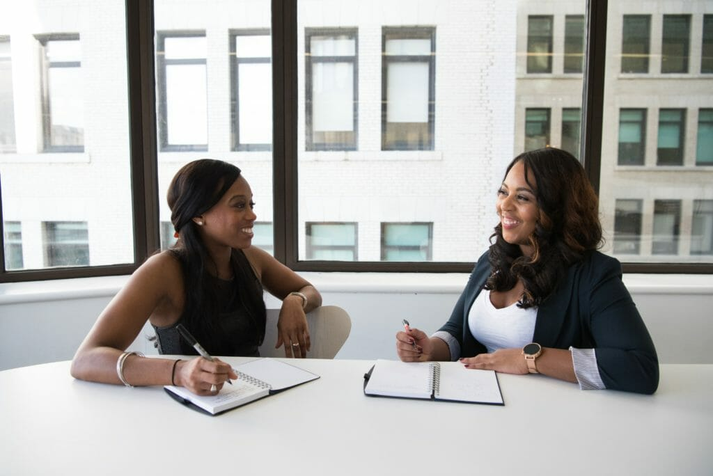 two ladies in an interview setting. image for what to do if your mind goes blank in interviews.