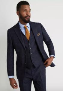 man in black suit with orange tie
