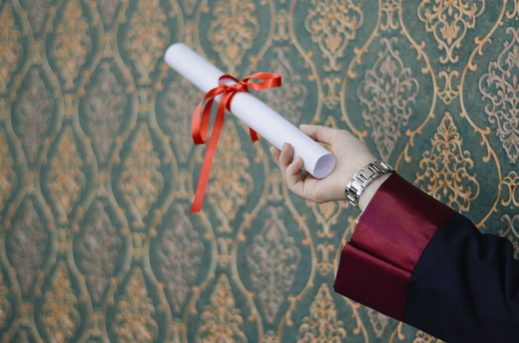 Graduate holding a degree scroll